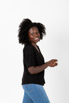 The Naya Scalloped Button Blouse in Black, studio shoot; side view
