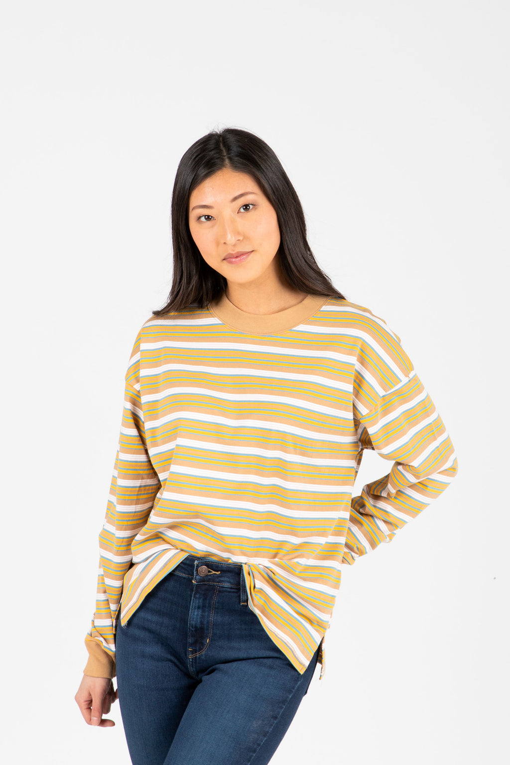 The Rina Striped Long Tee in Camel, studio shoot; front view