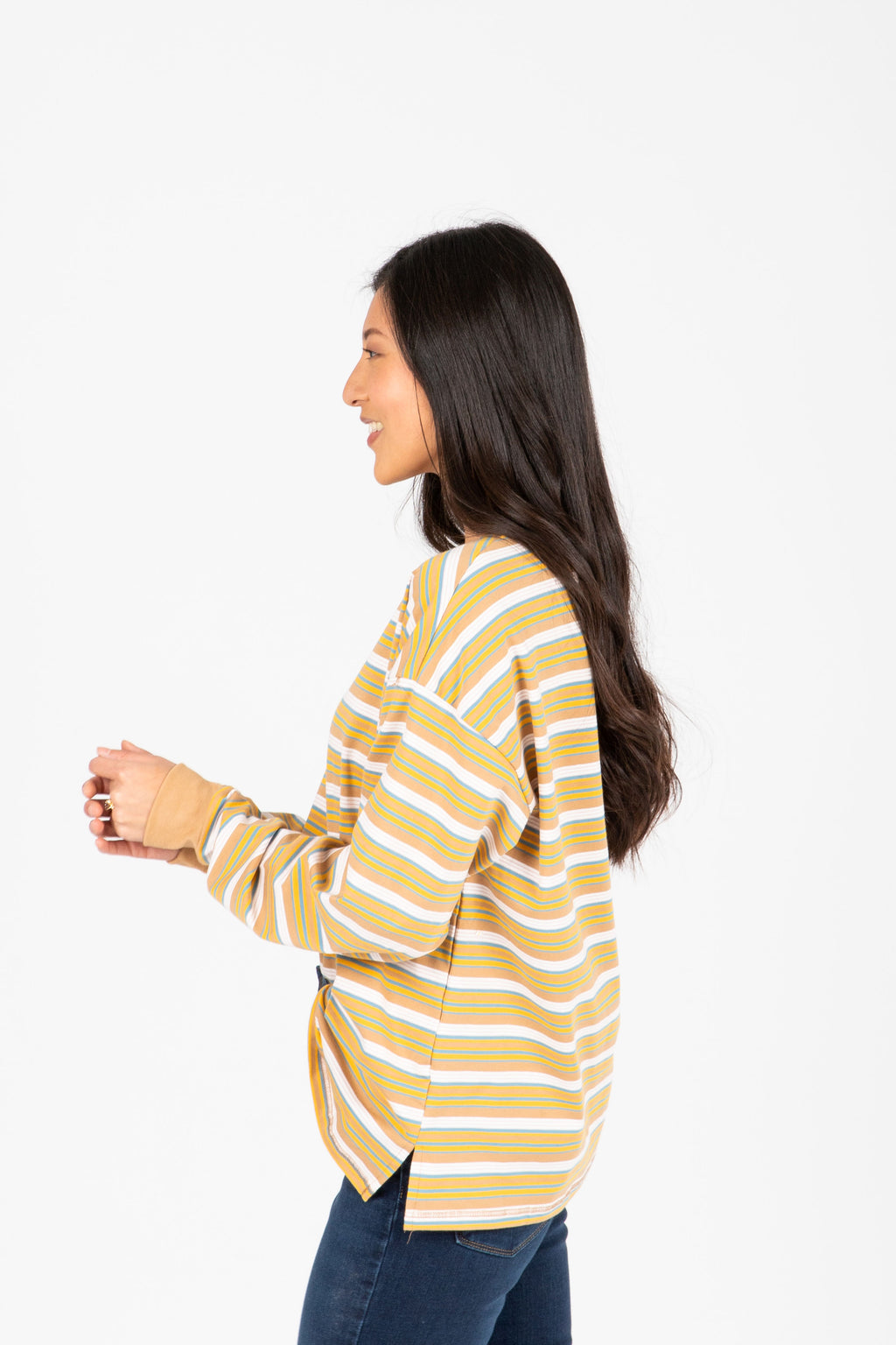The Rina Striped Long Tee in Camel, studio shoot; side view