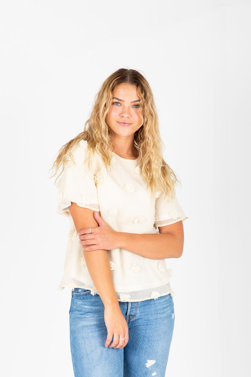 The Austin Textured Blouse in Cream, studio shoot; front view