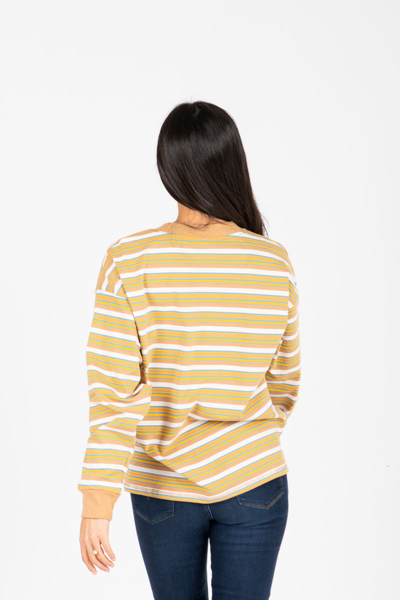 The Rina Striped Long Tee in Camel, studio shoot; back view