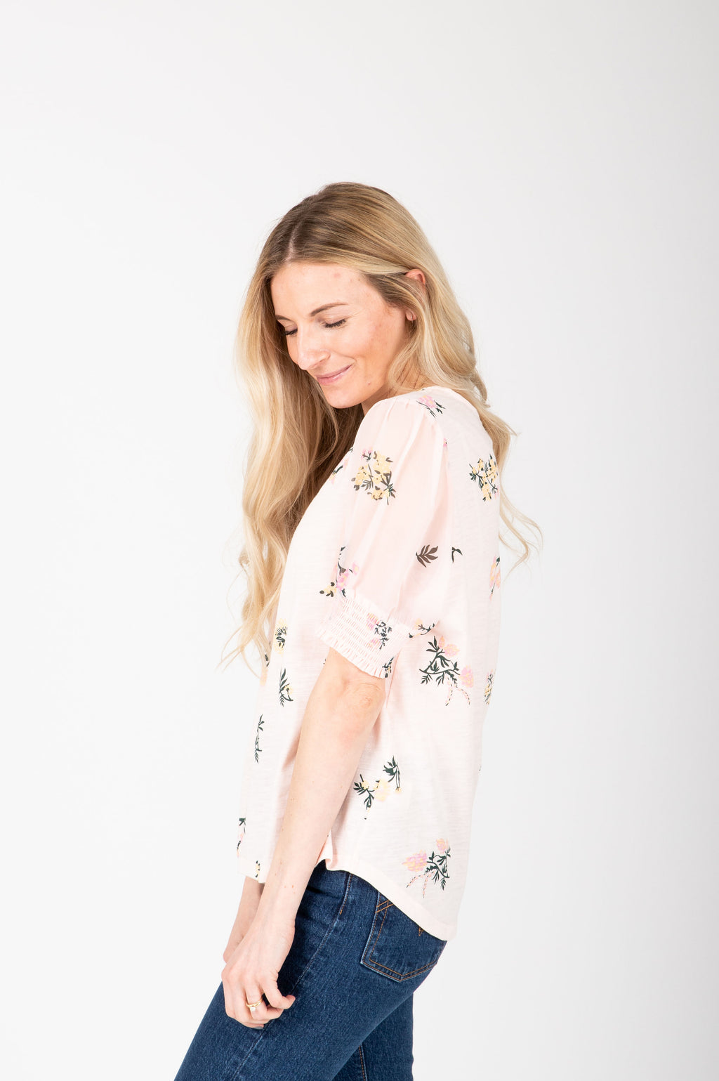 ,The Oaklyn Floral Smocked Blouse in Blush studio shoot; side view