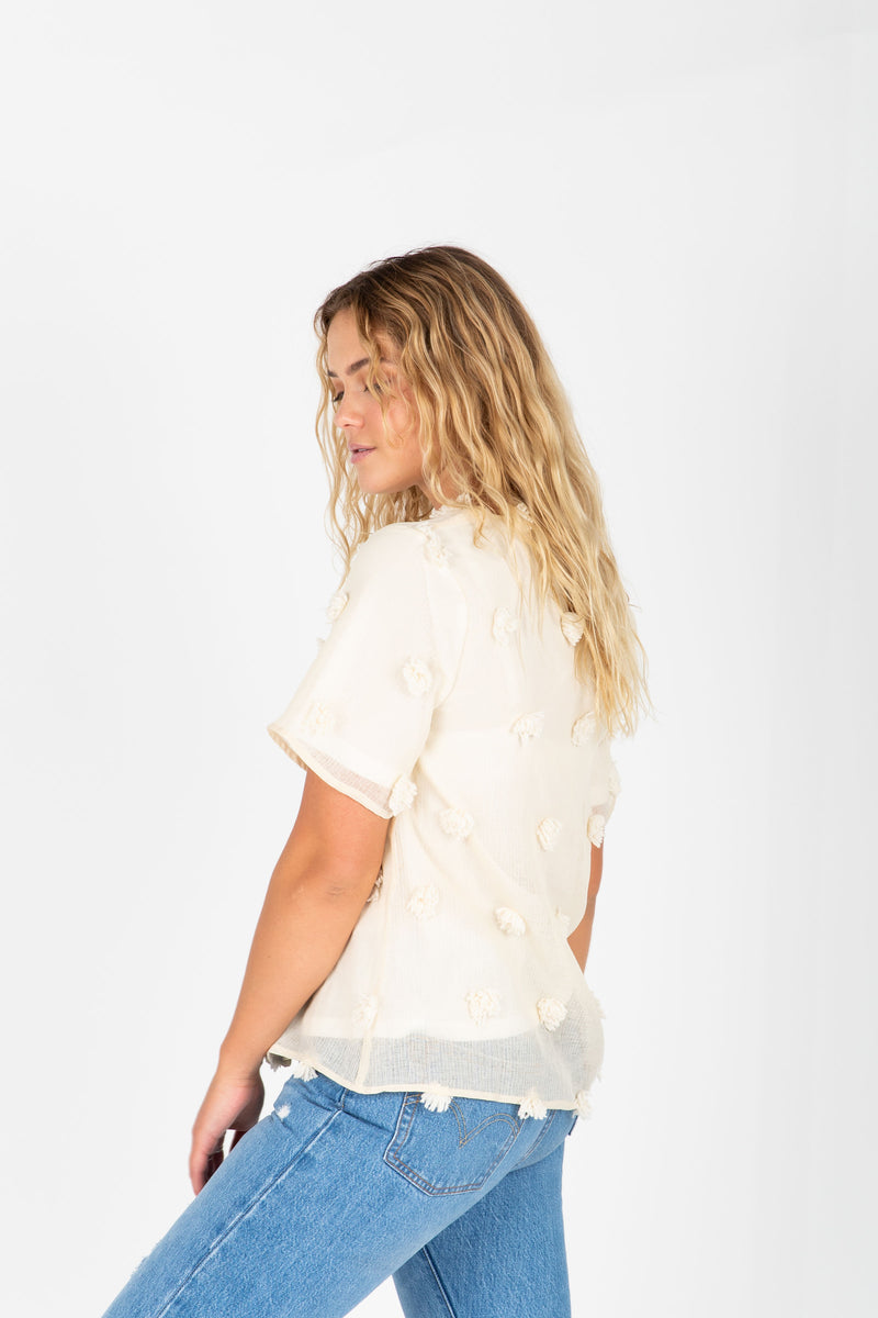 The Austin Textured Blouse in Cream, studio shoot; back view