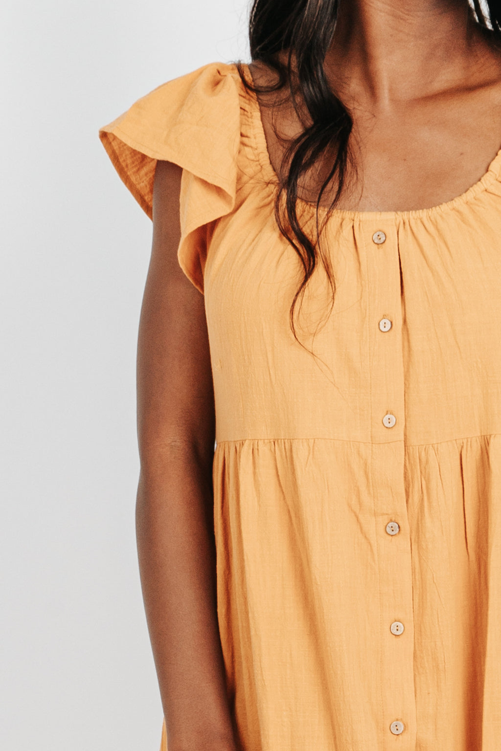 The Ivvy Button Down Midi Dress in Golden, studio shoot; front view