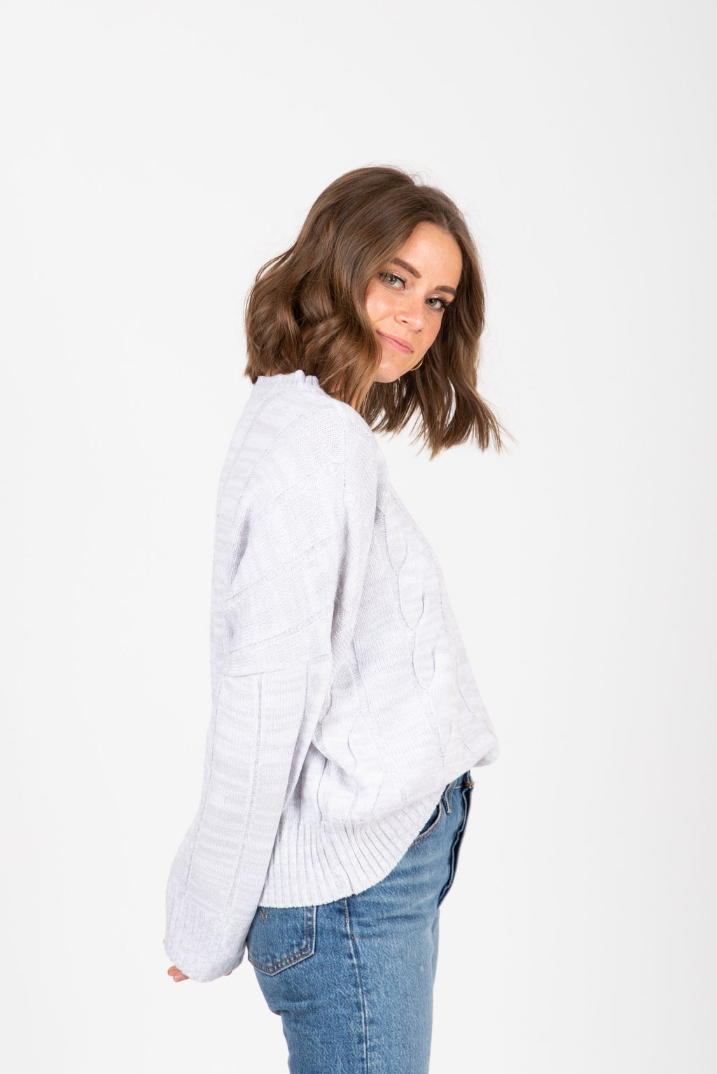 The Form Casual Sweater Blouse in Grey, studio shoot; side view