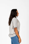 The Cranston Embroidered Empire Blouse in Navy, studio shoot; side view