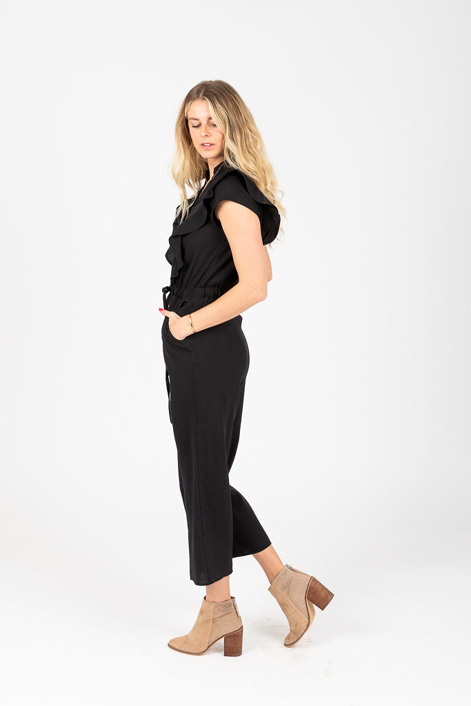 The Alexa Ruffle Button Jumpsuit in Black