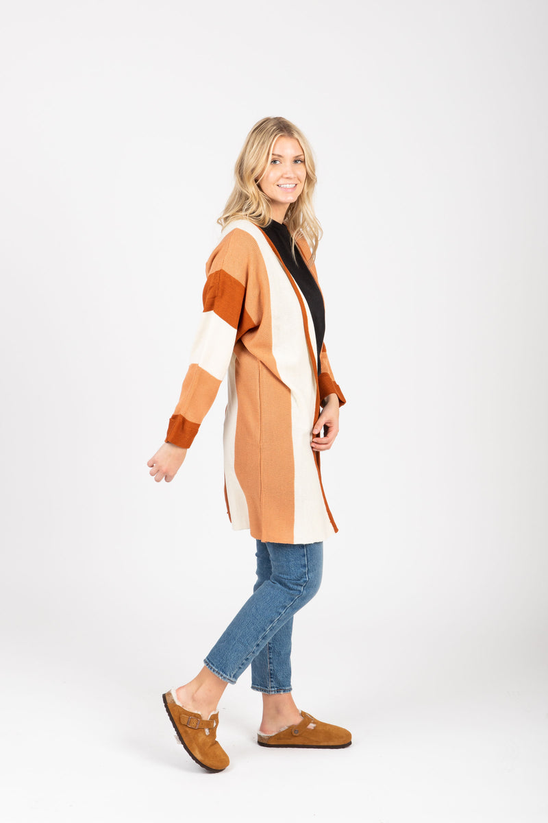 The Colin Striped Cardigan in Rust, studio shoot; side view