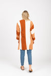 The Colin Striped Cardigan in Rust, studio shoot; back view