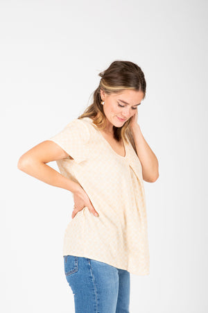 The Maisie Patterned Pleated Blouse in Pale Yellow, studio shoot; side view