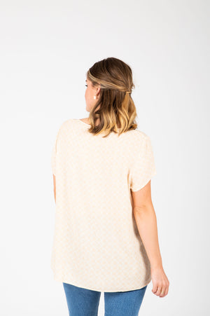 The Maisie Patterned Pleated Blouse in Pale Yellow, studio shoot; back view