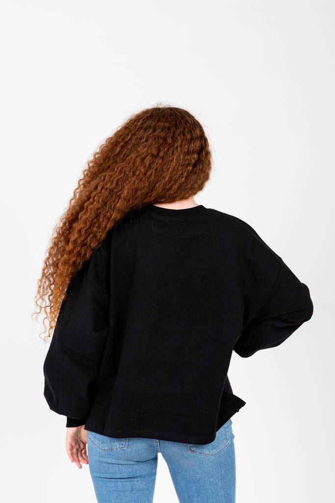 The Grint Balloon Sleeve Pullover in Black, studio shoot; back view