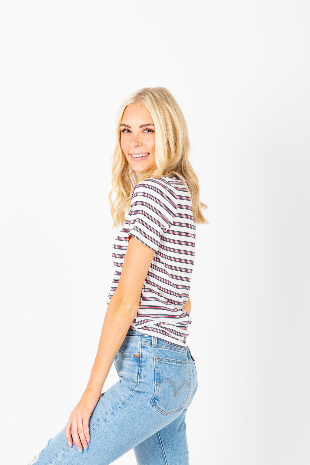 The Welker Striped Ribbed Tee in Navy, studio shoot; side view