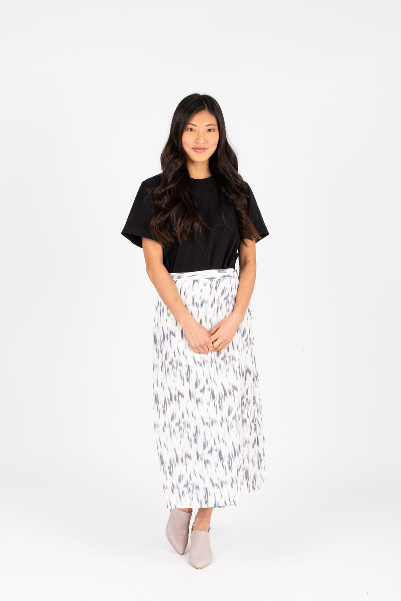 The Merrick Strokes Wrap Skirt in White, studio shoot; front view