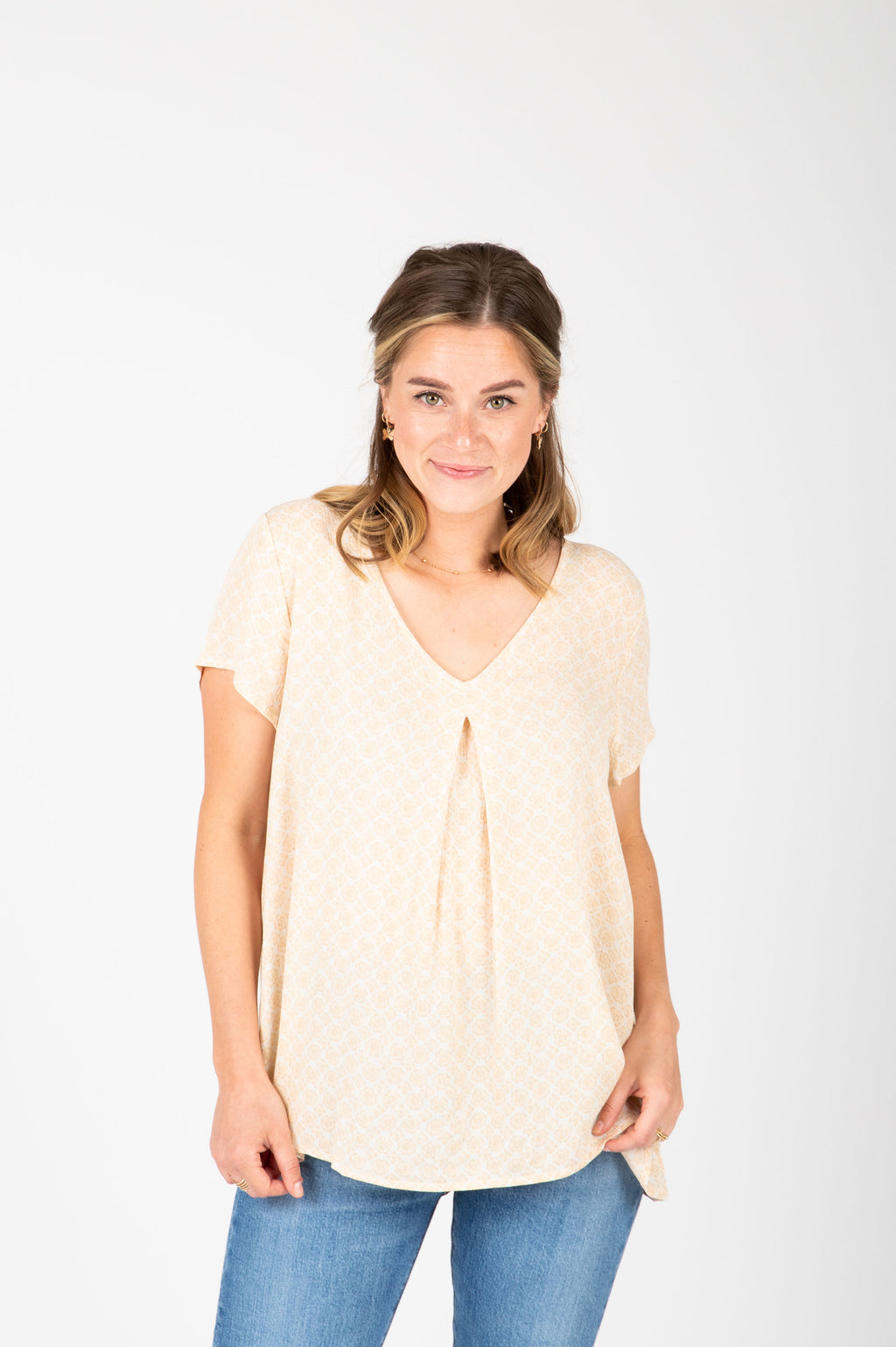 The Maisie Patterned Pleated Blouse in Pale Yellow, studio shoot; front view