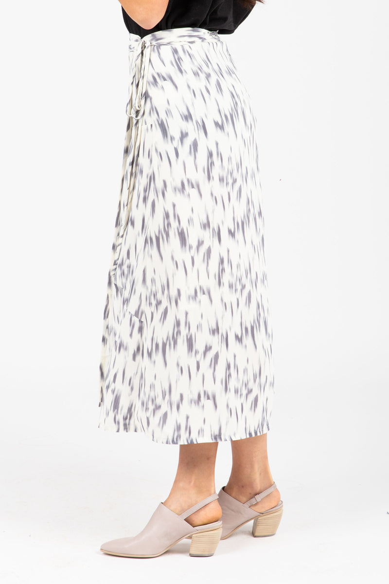 The Merrick Strokes Wrap Skirt in White, studio shoot; side view