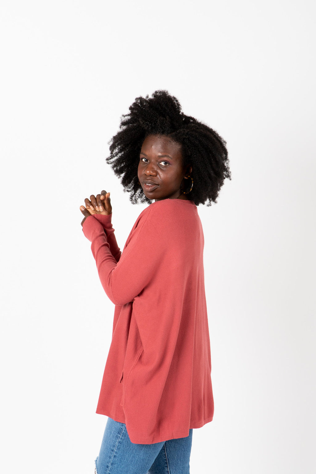 The Divina Casual Pocket Sweater in Brick, studio shoot; side view