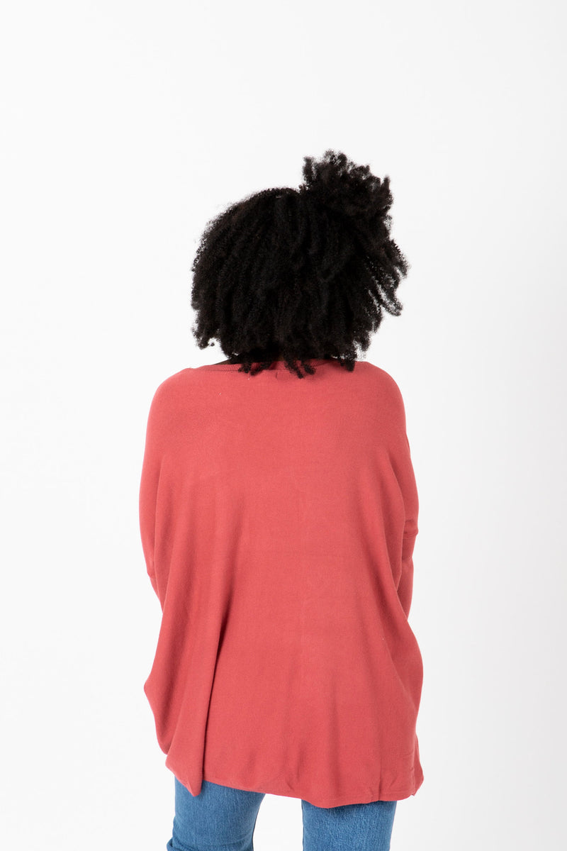The Divina Casual Pocket Sweater in Brick, studio shoot; back view