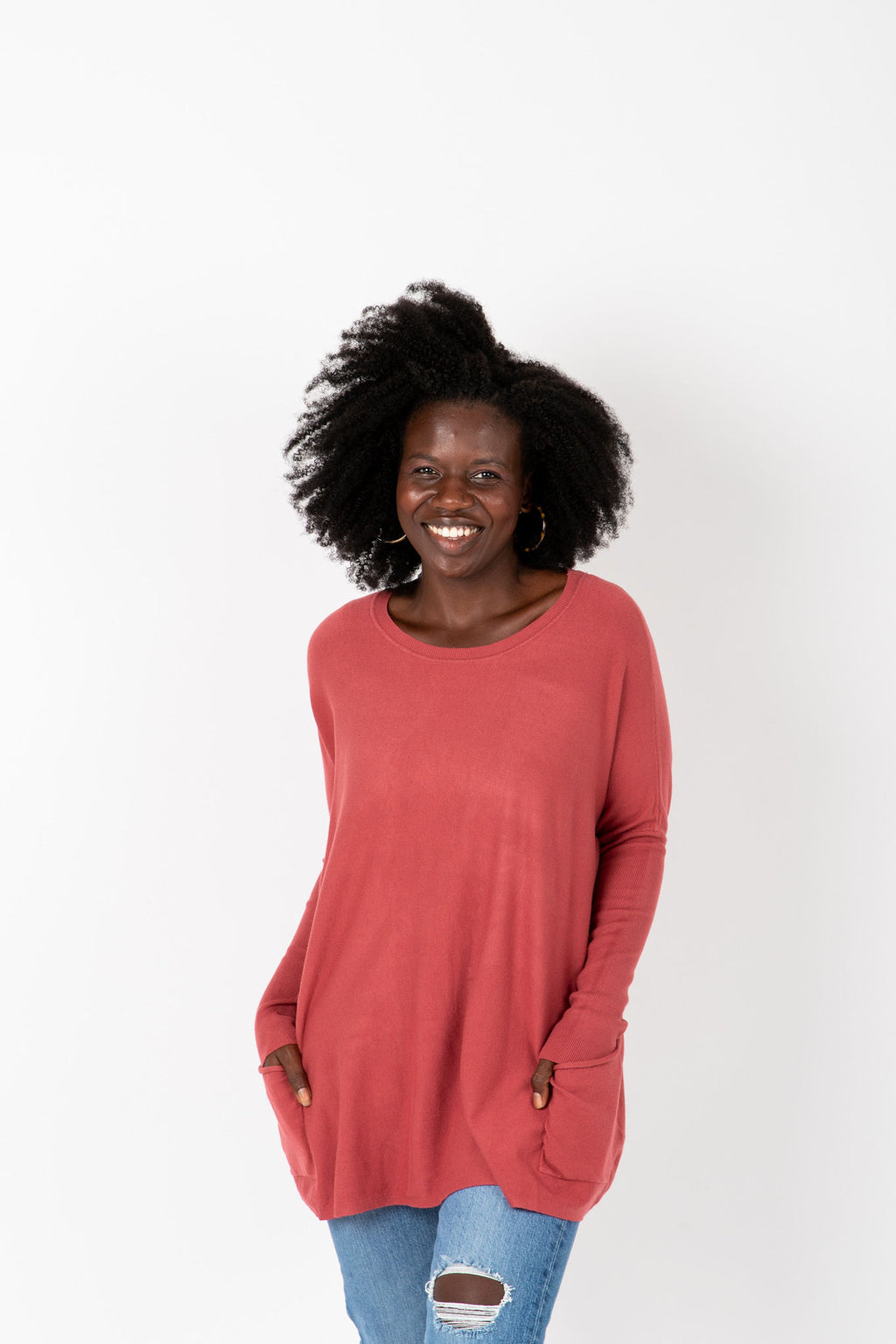 The Divina Casual Pocket Sweater in Brick, studio shoot; front view