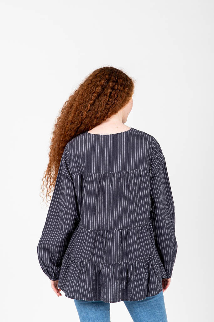 The Pat Striped Button Peplum in Navy, studio shoot; back view