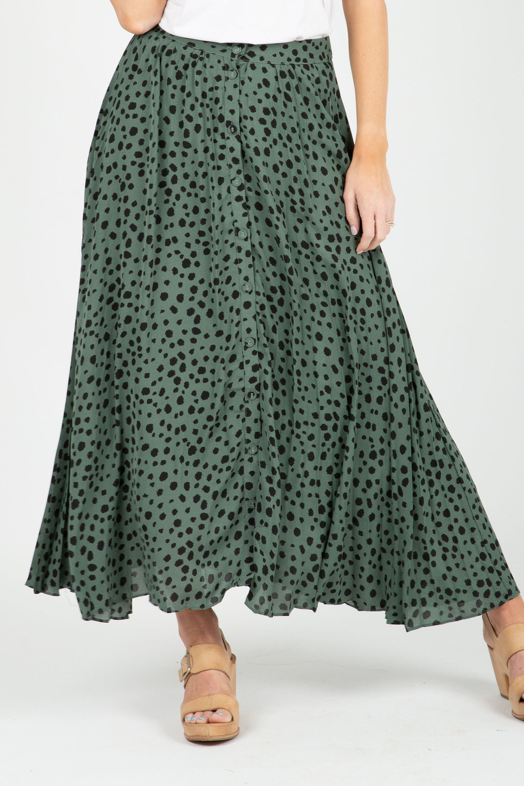 The Fletcher Dot Midi Skirt in Green, studio shoot; front view