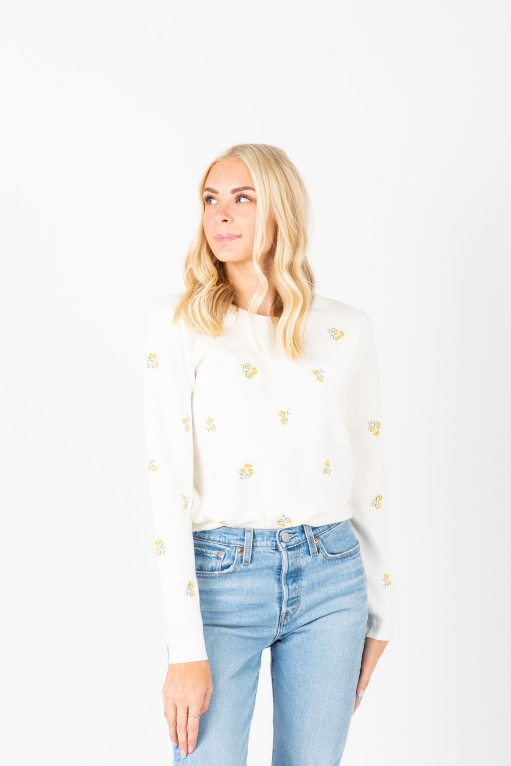 The Mullens Embroidered Flower Knit in White, studio shoot; front view