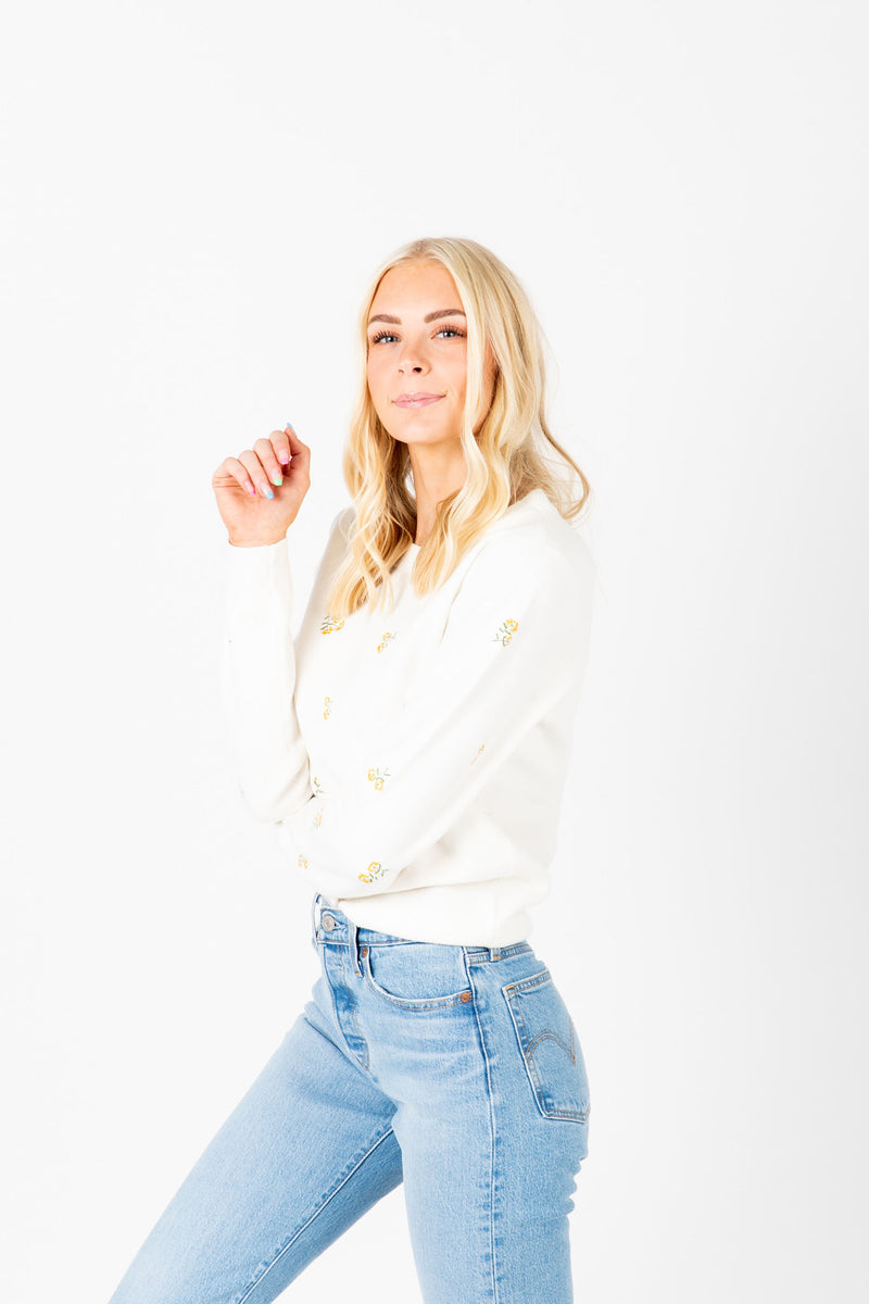 The Mullens Embroidered Flower Knit in White, studio shoot; side view