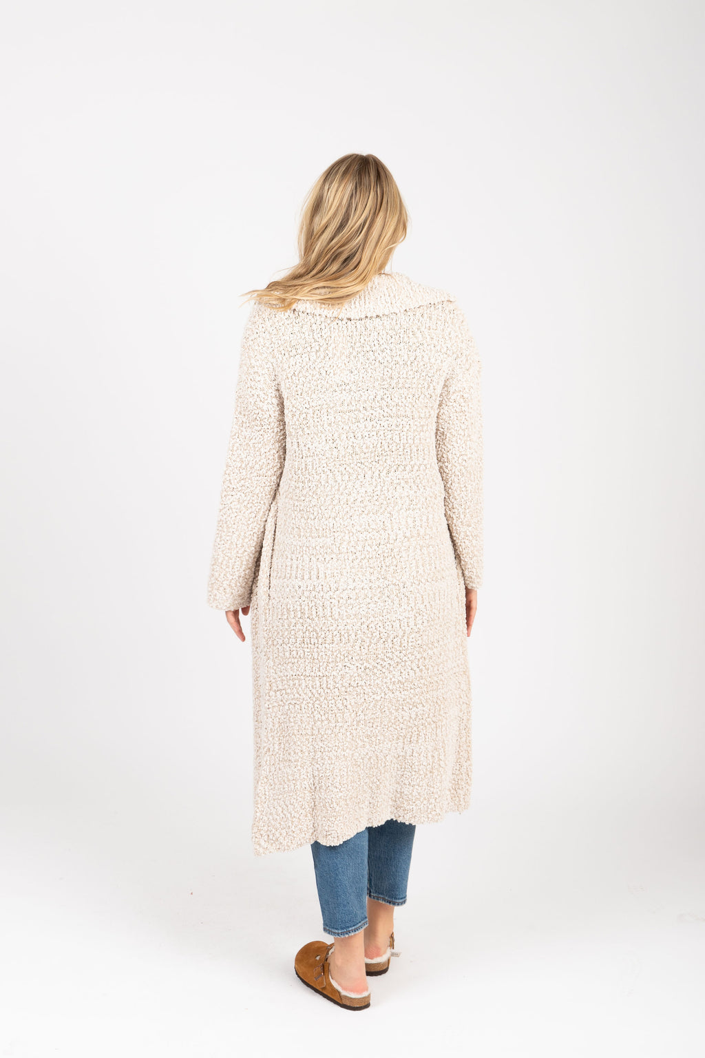 The Essence Lapel Sweater Cardigan in Cream, studio shoot; back view