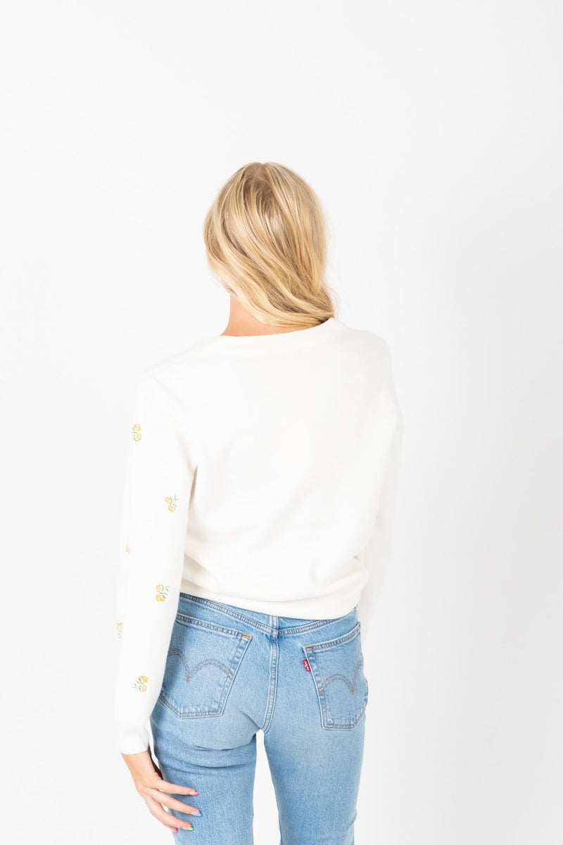 The Mullens Embroidered Flower Knit in White, studio shoot; back view