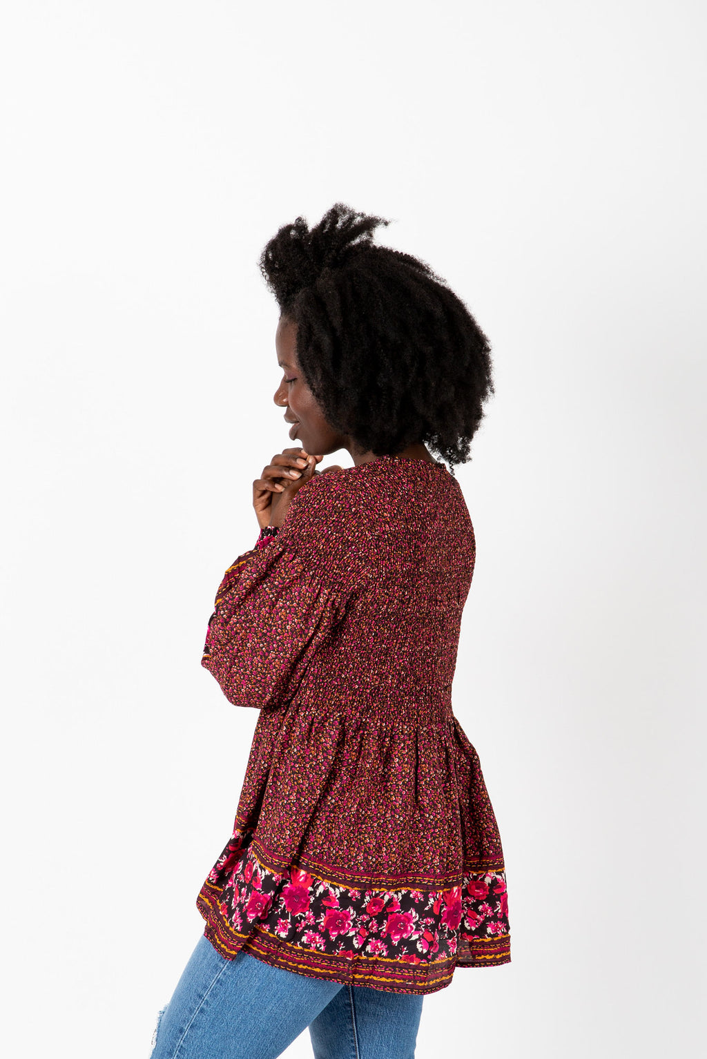 The Ronnie Patterned Peplum Blouse in Maroon, studio shoot; side view