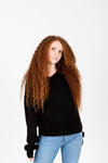 The Wynn Cozy V-Neck Pullover in Black, studio shoot; front view