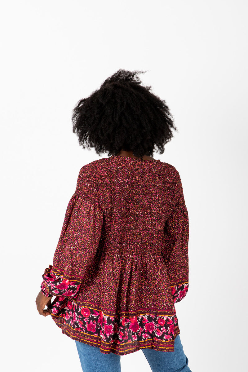 The Ronnie Patterned Peplum Blouse in Maroon, studio shoot; back view