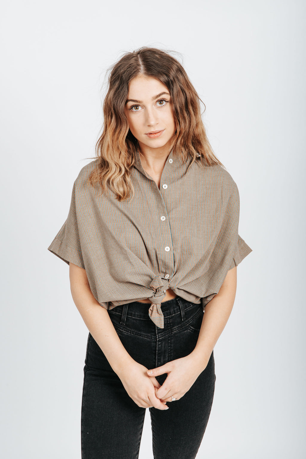 The Clint Striped Button Up Blouse in Brown, studio shoot; front view