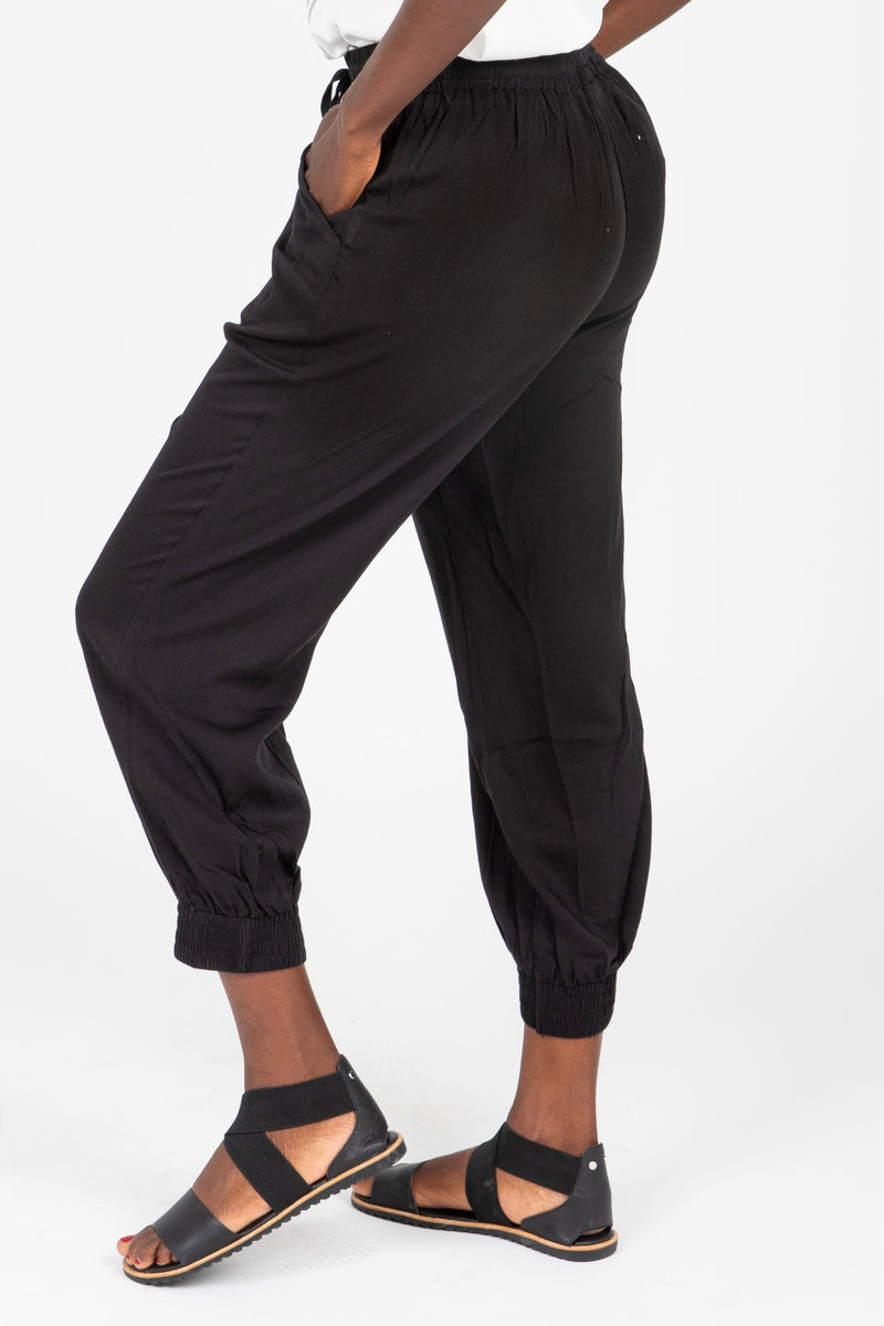 The Axel Jogger Trouser in Black, studio shoot; side view