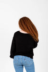 The Wynn Cozy V-Neck Pullover in Black, studio shoot; back view