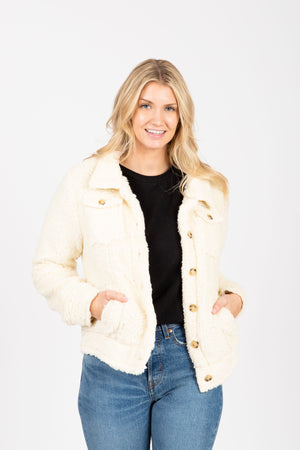 The Shashi Cozy Button Jacket in Cream, studio shoot; front view