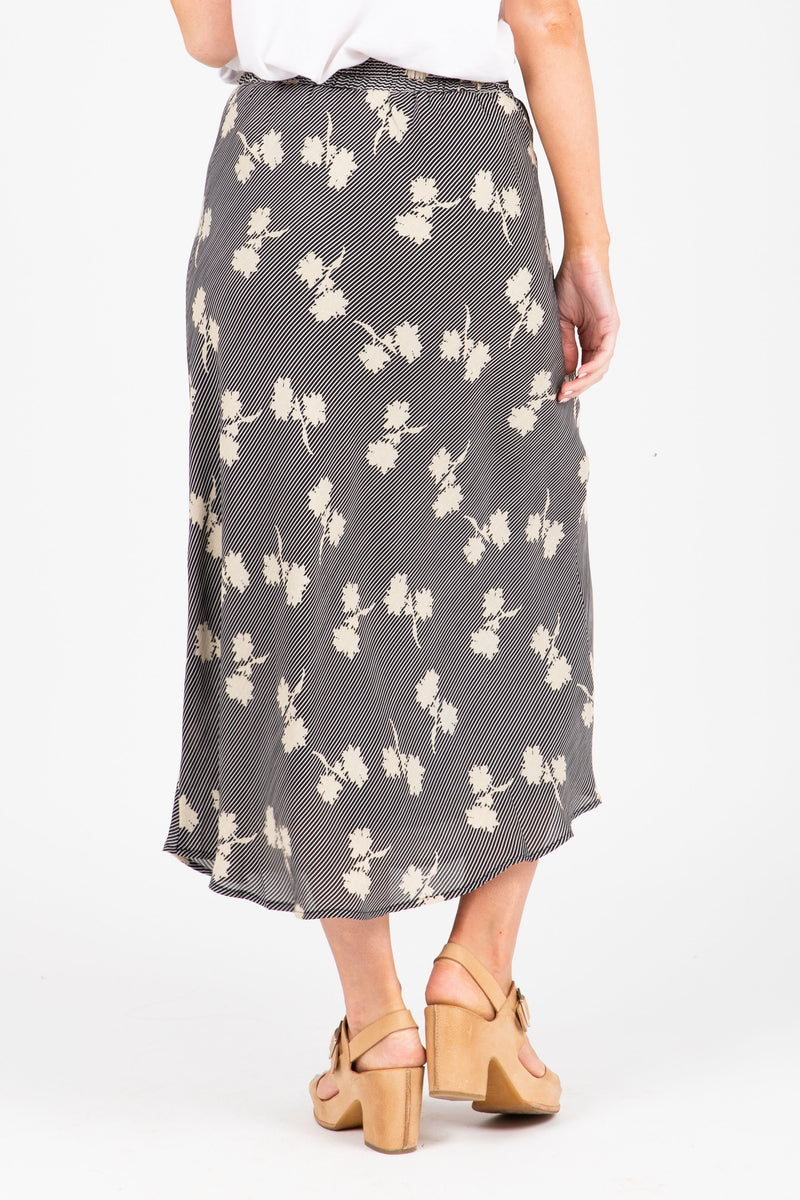 The Eason Patterned Silk Skirt in Black, studio shoot; back view