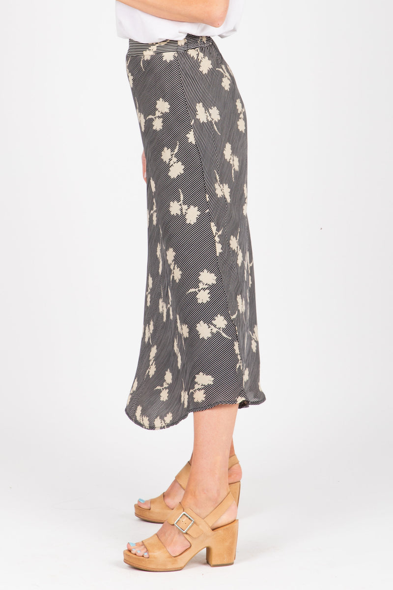 The Eason Patterned Silk Skirt in Black, studio shoot; side view