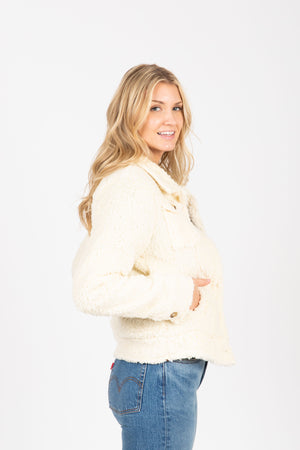The Shashi Cozy Button Jacket in Cream, studio shoot; side view