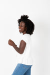 The Reni Crochet Detail Blouse in White, studio shoot; side view