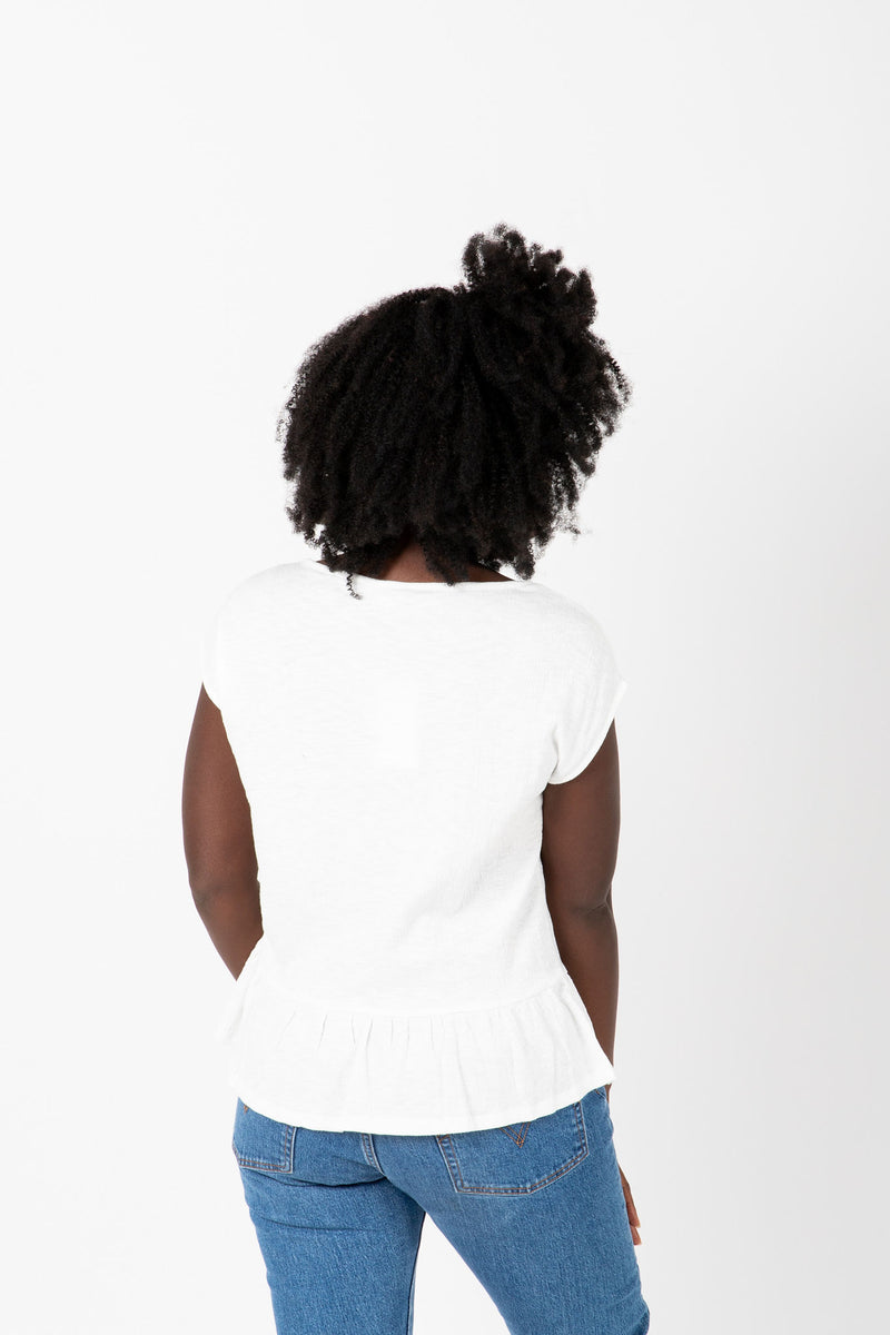 The Reni Crochet Detail Blouse in White, studio shoot; back view