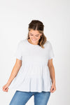 The Hattie Ruffle Peplum Blouse in Light Grey, studio shoot; front view