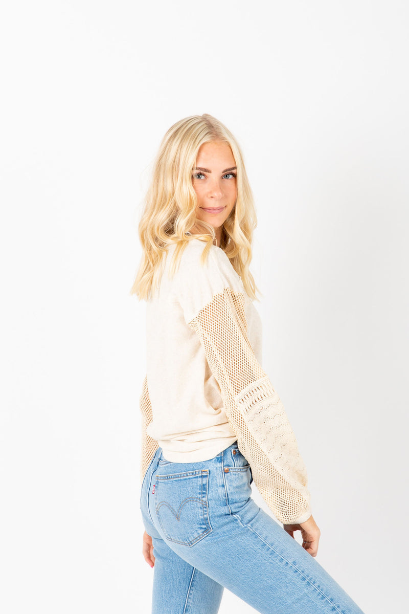 The Robinson Contrast Sleeve Blouse in Ivory, studio shoot; side view