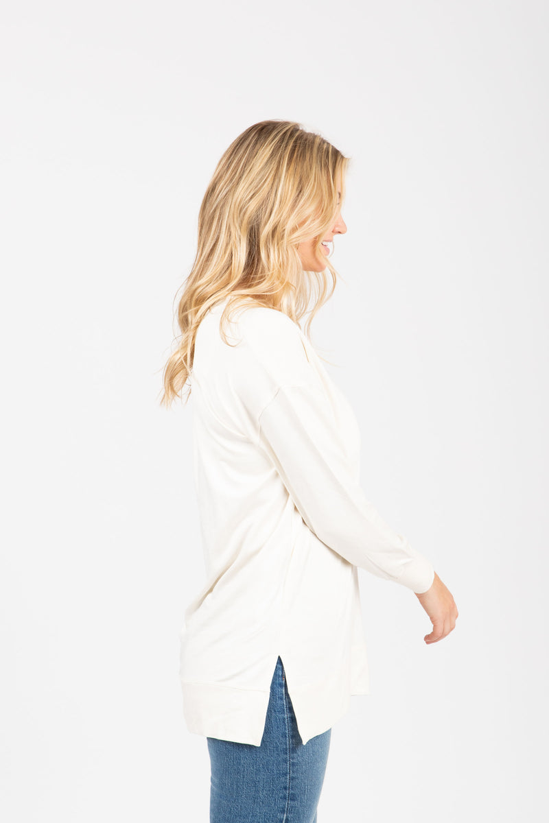 The Wendler V-Neck Casual Sweater in Cream, studio shoot; side view