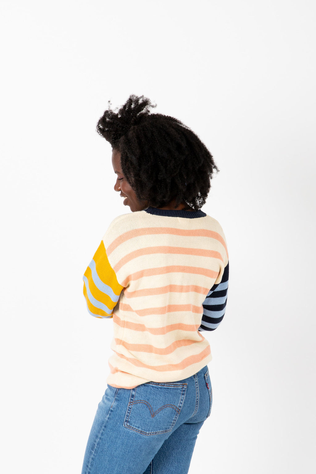 The Judge Striped Contrast Knit in Mustard + Peach, studio shoot; back view