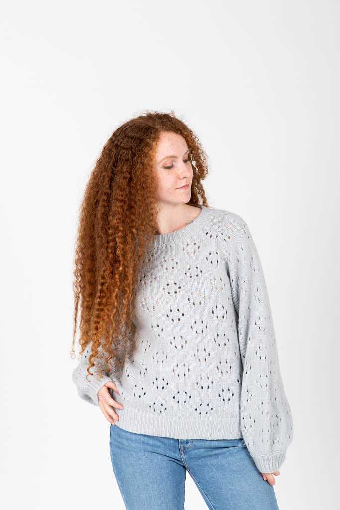 The Rickman Crochet Pattern Sweater in Light Grey, studio shoot; front view