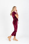 Piper & Scoot: The Bianca Cinch Velvet Jumpsuit in Burgundy, studio shoot; side view