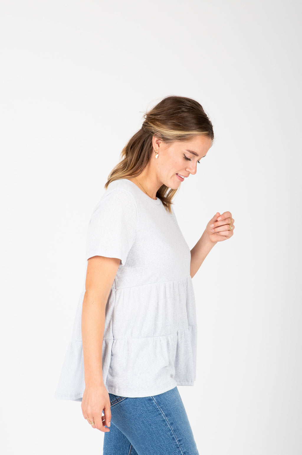 The Hattie Ruffle Peplum Blouse in Light Grey, studio shoot; side view