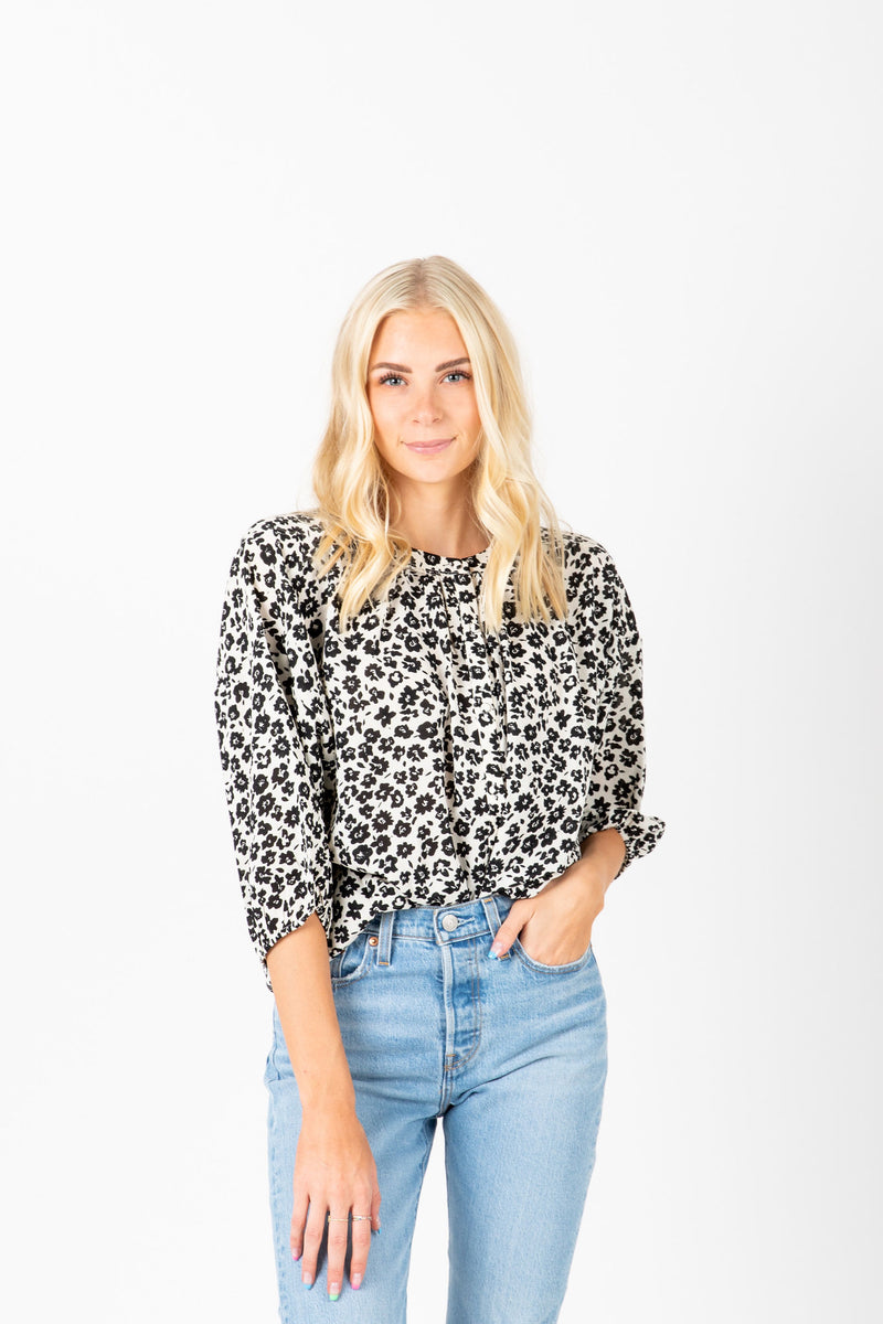The Hara Floral Blouse in Black, studio shoot; front view