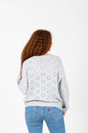 The Rickman Crochet Pattern Sweater in Light Grey, studio shoot; back view